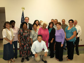 Former U.S. Attorney Dennis K. Burke (next to flag) thanks members of the Yuma Weed & Seed group for helping make their communities safer.(May 2011)