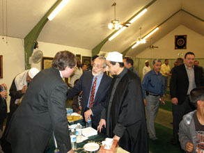 Former U.S. Attorney Dennis K. Burke (on left in photo) and several members of the USAO conducted outreach to the Islamic Community Center of Phoenix on February 26, 2011.  After evening prayers, USAO staff gave an office overview presentation, with an emphasis on civil rights.  After the presentation, they were treated to a traditional meal of lamb, chicken, and rice.