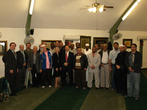 Former U.S. Attorney Dennis K. Burke (far left in photo) and several members of the USAO in Arizona conducted outreach to the Islamic Community Center of Phoenix on February 26, 2011.  After evening prayers, the USAO staff gave an office overview presentation, with an emphasis on civil rights.