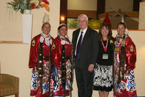 Kip Crofts, U.S. Attorney for the District of Wyoming, poses with the color guard of the Native American Women Warriors
