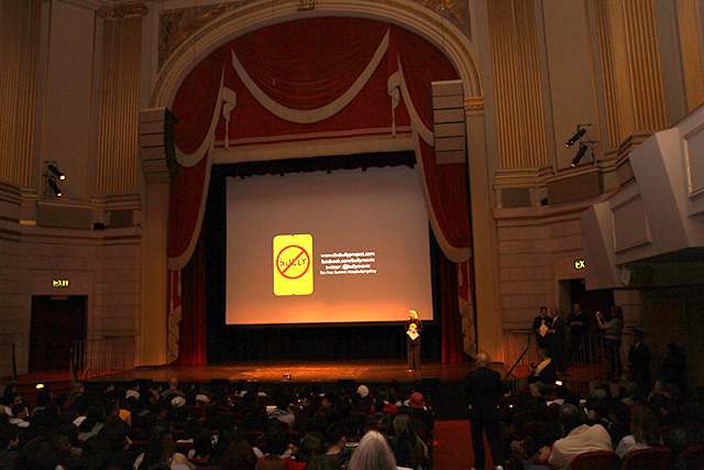 U.S. Attorney Haag addresses a packed house at Herbst Theater