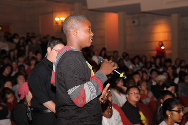 High school student Delvon Carter asking a question of the panel