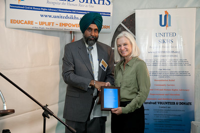 Jatinder Singh with U.S. Attorney Melinda Haag.
