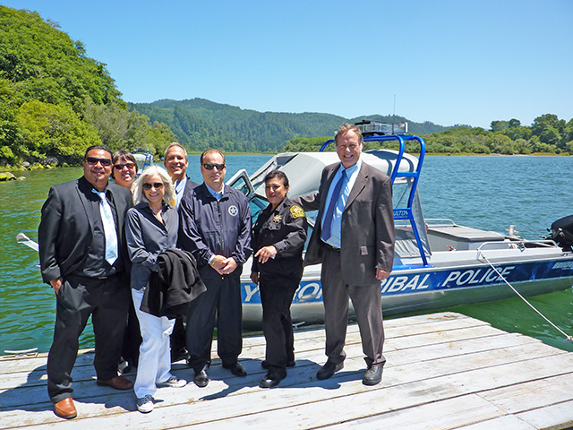 U.S. Attorney Melinda Haag joined by Javier Kinney, Director of the Office of Self Governance of the Yurok Tribe, Joyce Mosier, Humboldt County District Attorney Paul Gallegos, U. S. Marshal Donald O'Keefe, Yurok Police Chief Mary McQuillen, and John Corbett, Yurok Tribal Attorney while visiting the Yurok reservation.