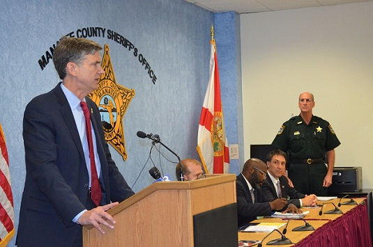 Pictured – Center: U.S. Attorney Lee Bentley; Left to right: Assistant State Attorney, Fourth Judicial Circuit Mark Caliel, Jacksonville Sheriff's Office Undersheriff Dwayne Senterfitt, Florida Department of Law Enforcement Jacksonville Regional Special Agent in Charge Dennis Bustle, Special Agent in Charge for the Southeast Field Office of the U.S. Naval Criminal Investigative Service Andrew Snowdon, Jacksonville FBI Supervisory Special Agent/Violent Crimes Squad Deborah McCarley, and Jacksonville Sheriff's Office Sheriff John Rutherford