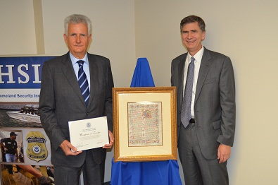 Consul General and U.S. Attorney with the recovered Italian manuscript
