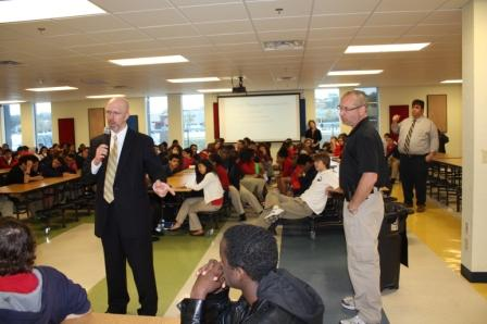 AUSA Frank Talbot addresses students on Project Save Neighborhoods (PSN) on the topic of Gun Safety