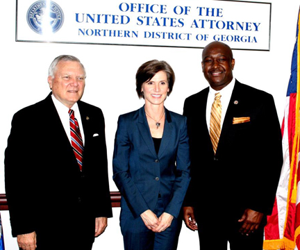 U.S. Attorney Sally Quillian Yates with Georgia Governor Nathan Deal (L) and Assistant U.S. Attorney and Community Outreach Coordinator Loranzo M. Fleming (R) at the Summit on Reentry