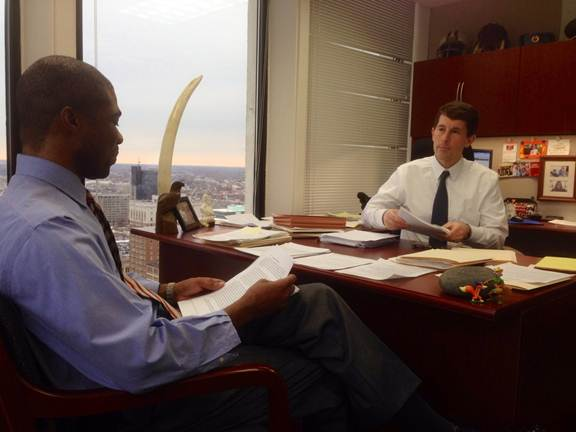 Assistant U.S. Attorney Eric Doeh discusses a drug trafficking case with Drug Task Force Chief David Gardey.