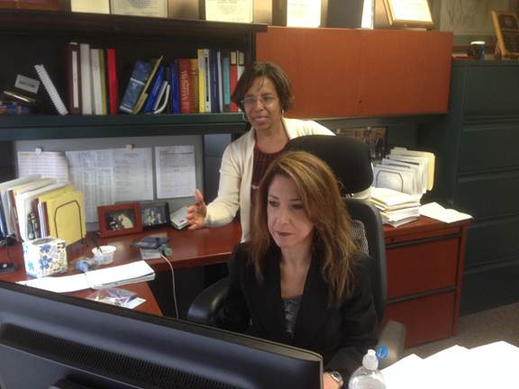 Assistant U.S. Attorney Regina McCullough and Deputy Chief Sarah Cohen discuss a brief in a health care fraud case.