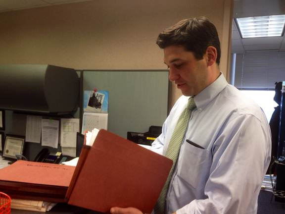 Assistant U.S. Attorney Patrick Hurford reviews a white collar crime file.