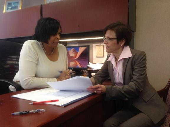 Defensive Litigation Chief Vanessa Mays and Civil Rights Unit Chief Judy Levy discuss a civil settlement.