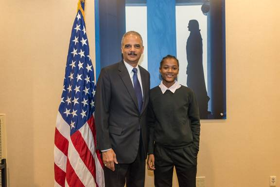 U.S. Attorney General Eric H. Holder, Jr., hosted Keana Pearl and other Detroit high school students at the National Forum on Youth Violence Prevention in Washington, D.C., in September.