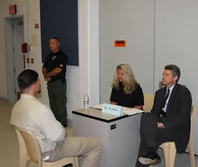 Tim Heaphy works with an offender at USP Lee who is practicing job interviews with a local employer.
