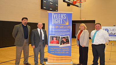 Pictured left to right: Wayne Campbell, president of Tyler's Light; Dick Taylor, principal at Corpus Christi School; Becky Beabout, principal at St. Vincent de Paul Parish School; and, Lee Gruber, principal at St. Michael Parish School.